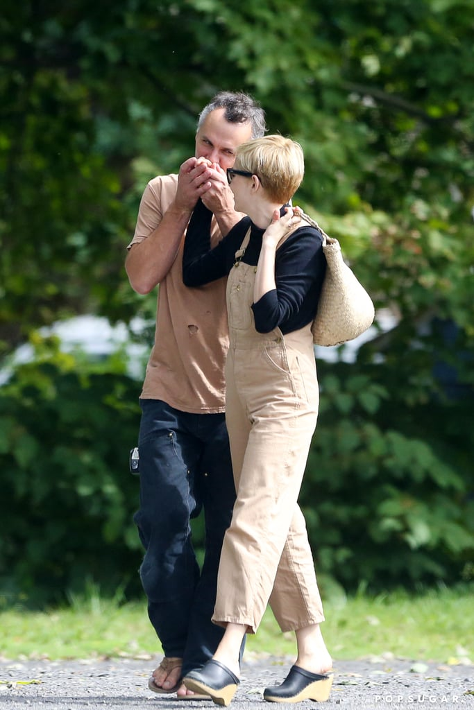"Michelle Williams was the picture of wedded bliss over the weekend as she did some antique shopping in upstate New York with her husband, Phil Elverum. The couple, who tied the knot in July, were spotted walking side by side and at one point, Phil sweetly kissed Michelle's hand — did you hear that? It's the entire world saying, ""Awww!"" Michelle surprised us all with the news of her wedding in the September issue of Vanity Fair. The 38-year-old actress married Phil, a 40-year-old musician, in a private ceremony in the Adirondack Mountains with ""only a handful of friends"" and their two daughters; Michelle has a 12-year-old daughter, Matilda, from her previous relationship with the late Heath Ledger, and Andrew has a daughter from his marriage to Geneviève Castrée, who died of pancreatic cancer in July 2016.  ""I never gave up on love,"" Michelle said in her Vanity Fair interview, adding, ""Ultimately the way [Phil] loves me is the way I want to live my life on the whole. I work to be free inside of the moment. I parent to let Matilda feel free to be herself, and I am finally loved by someone who makes me feel free.""      Related:                                                                                                           Who Has Michelle Williams Dated? Look Back at Her Under-the-Radar Romances"