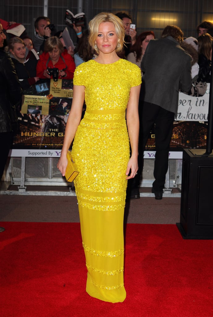 She isn't afraid of brighter than bright colours. Case in point: this saturated yellow Bill Blass cap-sleeved gown she wore at the London premiere of The Hunger Games.