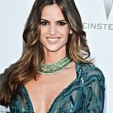 Izabel Goulart wore a green, diamond-accented collar.