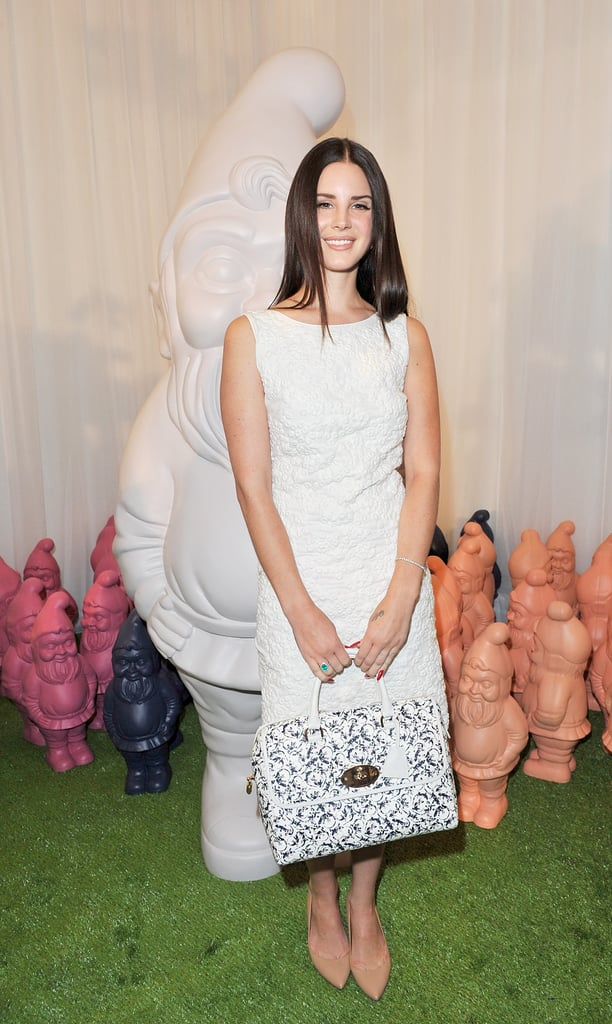 Lana Del Rey arrived at Mulberry in a chic white sheath — and a Mulberry bag in hand.