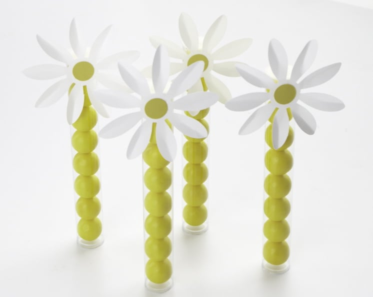 Give them something sweet to take home from the party! These daisy gumball favors can be put together in a few short steps.  Source: Photos by Bryan Gardner. Courtesy of Martha Stewart