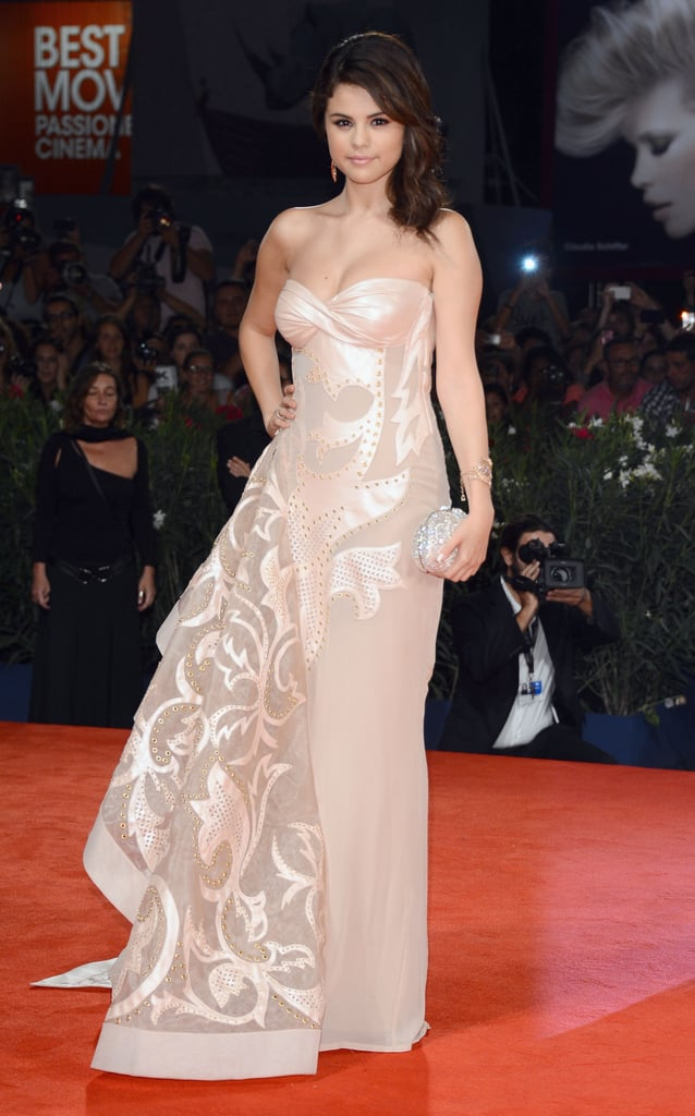 Selena had a major glamour moment in her blush strapless Atelier Versace gown, from the Fall 2011 collection, at the Spring Breakers premiere at the 2012 Venice Film Festival. Lorraine Schwartz jewels, a sparkling Judith Leiber clutch, and nude Sergio Rossi sandals completed her red-carpet style.
