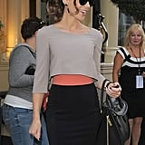 The coral band at the waistline of her Paule Ka skirt offers up a cool colorful contrast to the toned-down look.