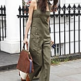 Amal's military-green Sonia Rykiel jumpsuit was, in fact, an on-the-go airport outfit. We love how she kept cool by going bare underneath but added a few neutral staples like peep-toe mules and a LaLa Queen carry-on bag.