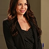 See? This staple even makes Mona's feminine dress look polished and professional.