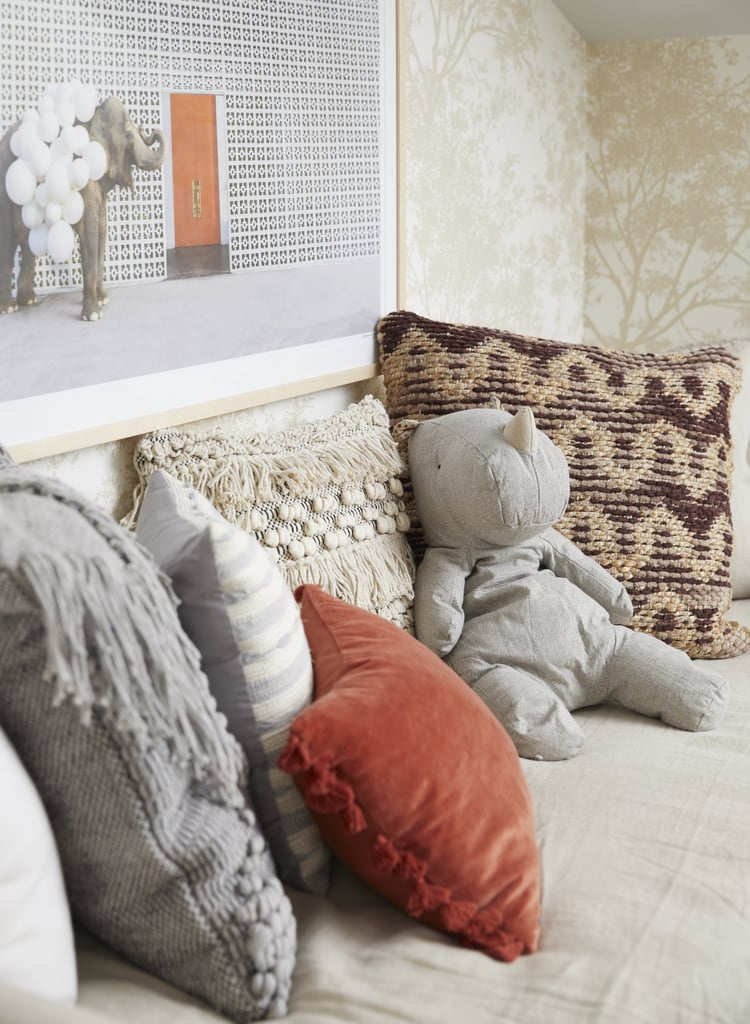 "For the spacious seating-slash-napping-area, Donna explains, ""We brought in a twin-size linen daybed for cuddling with Sonny during the long nights."" A framed Grey Malin photograph and some richly textured throw pillows serve to add to the whimsical vibe."