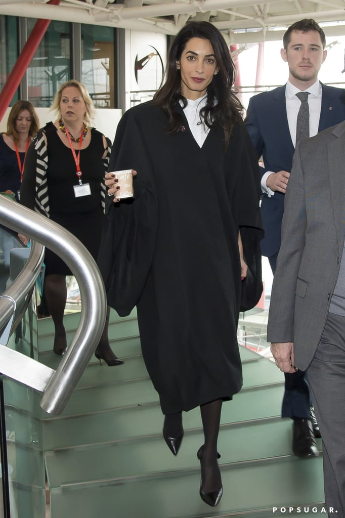 """Following her picture-perfect airport arrival earlier this week, Amal Clooney made her way to the European Court of Human Rights in Strasbourg, France, on Wednesday. The civil rights lawyer is representing Armenia in a genocide trial, switching gears after attending the Golden Globes with her husband, George Clooney. On her way into court, she was asked about her fashion choices, and she joked, """"I'm wearing Ede & Ravenscroft"""" — giving a nod to her legal robe. Well played! See more pictures from Amal's arrival in court."""
