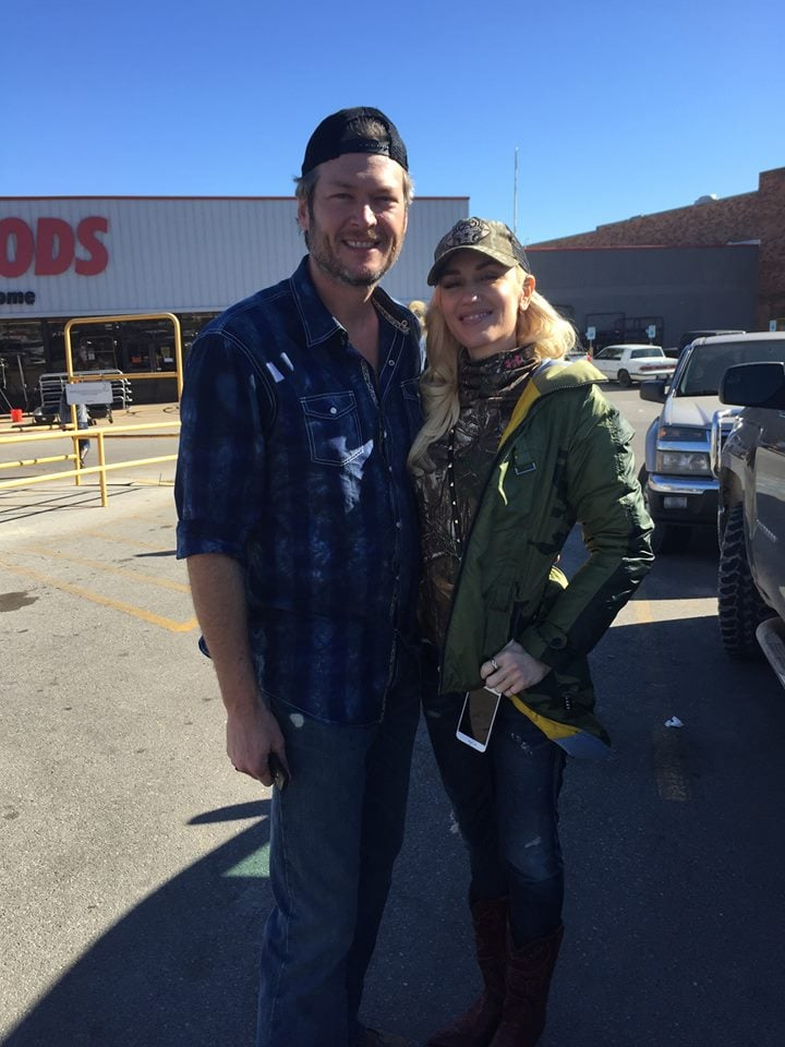 """Nothing says, """"I love you,"""" like spending the holidays with your significant other. Just days after Gwen Stefani shared a video of Blake Shelton kissing her on Twitter, the pair was spotted together at Atwoods Ranch and Home in Oklahoma on Wednesday. The outing was captured on a couple of social media posts shared by Facebook users Janet Williams Zacharias and John T. Price. In one of the snaps, Blake and Gwen are pictured wearing matching caps and happily smiling outside of the ranch supply store, while in the other, the pair is shown posing with a fan.  Earlier this month, Blake — who's been dating Gwen since November — praised Gwen after her emotional performance on The Voice, saying, """"She deserves it. If you go through whatever she went through to write that song, at least she's getting something good, positive out of it."""" Shortly after, the duo channeled The Notebook during a sweet PDA-filled outing in LA and celebrated the engagement of RaeLynn, Blake's former teammate on the singing competition show, in Nashville. Read on to see more of Gwen and Blake, and then check out their cutest moments on social media."""