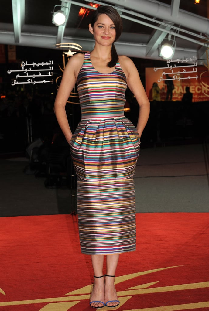 This colourful striped Dior dress fit Marion Cotillard perfectly when she wore it on the A Thousand Times Good Night red carpet in Marrakech.