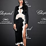 Adriana Lima stepped out in a black-with-white-lace-trim gown — and matching shoes — at Chopard's Cannes fete.