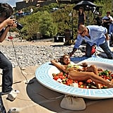 A set assistant helped Lisa look her best as she sat in the salad bowl.  Photo courtesy of The CW