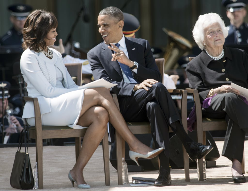 Michelle Obama completed the Zac Posen look with a pair of understated heels and layers of pearls, sitting next to the president at the dedication ceremony.