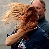 A woman's hair is swept by the winds in lower Manhattan.