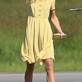 Kate Middleton held her hair back on the tarmac.