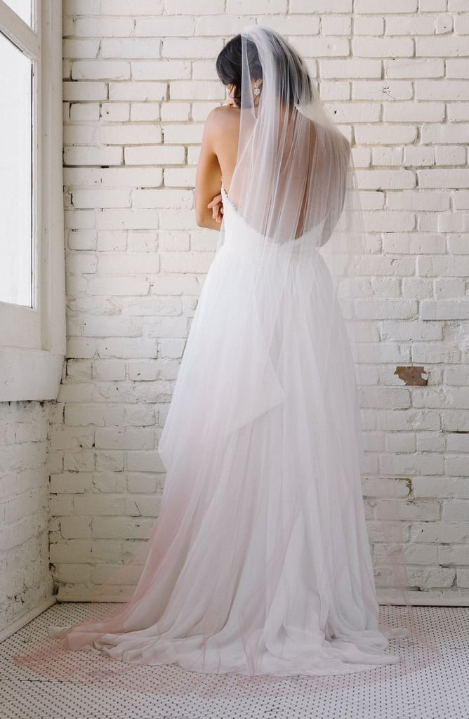 If you're looking for a light and airy piece, we suggest Sara Gabriel's chapel veil ($493).