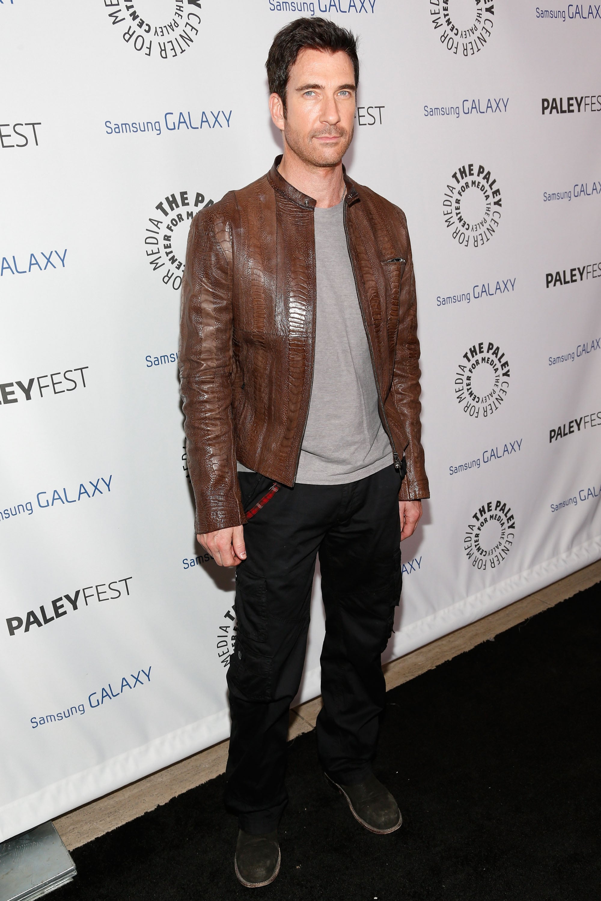 Dylan McDermott wore a brown leather jacket.