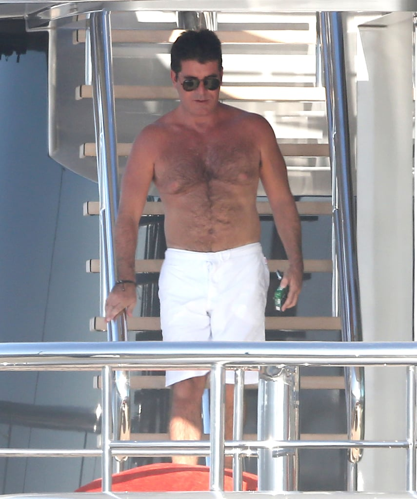 Simon Cowell walked down to the yacht's lower level.