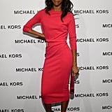 If you're more of a solids girl, then turn to Zoe Saldana's bright pink formfitting dress. We dig that she added a bit of edge via black cutout sandals.