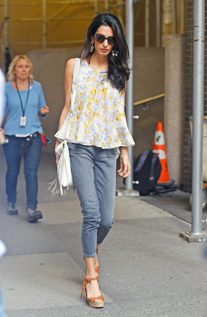 Going for the boho look in cropped gray skinnies, a flouncy Giambattista Valli trapeze top, Valentino wedges, and a fringed B-Low the Belt bag.