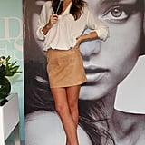 Miranda Kerr wore a short skirt to the skincare event.