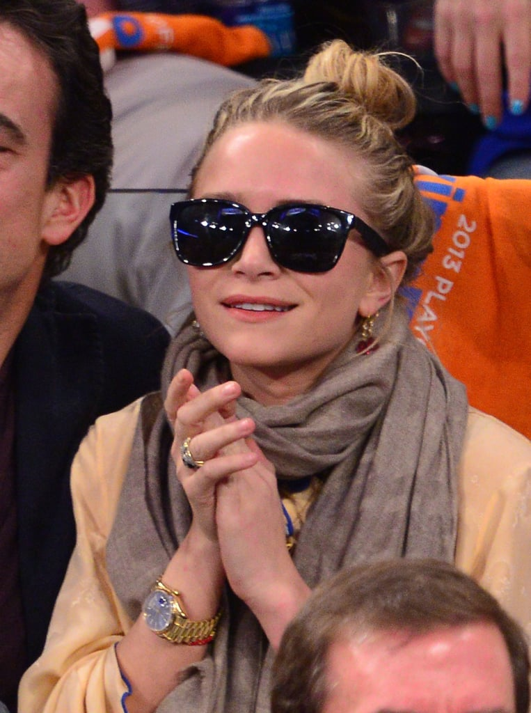 Mary-Kate contrasted a light top and scarf with her dark, structured shades at a New York Knicks game in 2013.