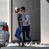 Anne Hathaway and Adam Shulman ran to the car from the furniture store.