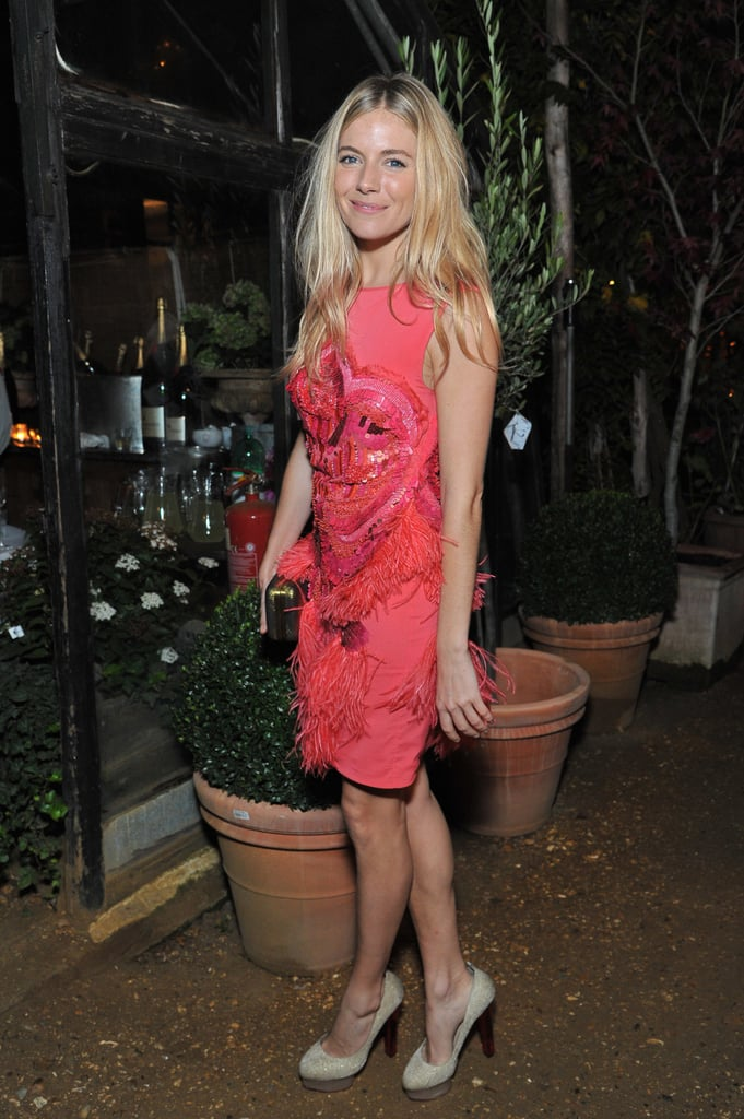 Sienna Miller wears pink to an All Saints event in England.