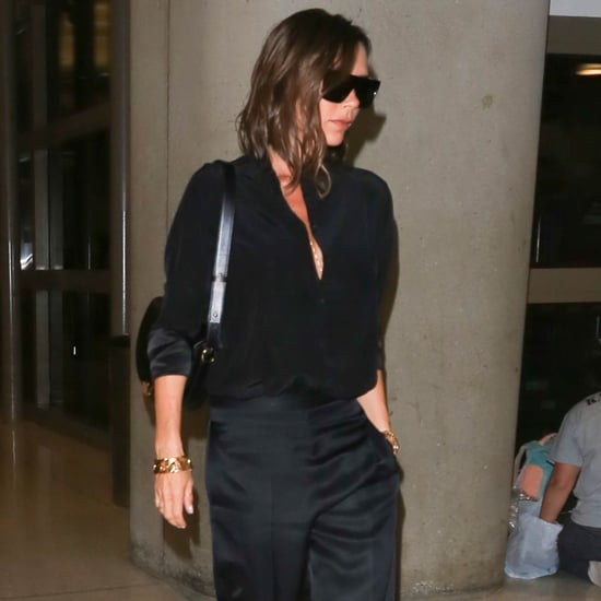 Victoria Beckham Wearing Silk Trousers at the Airport