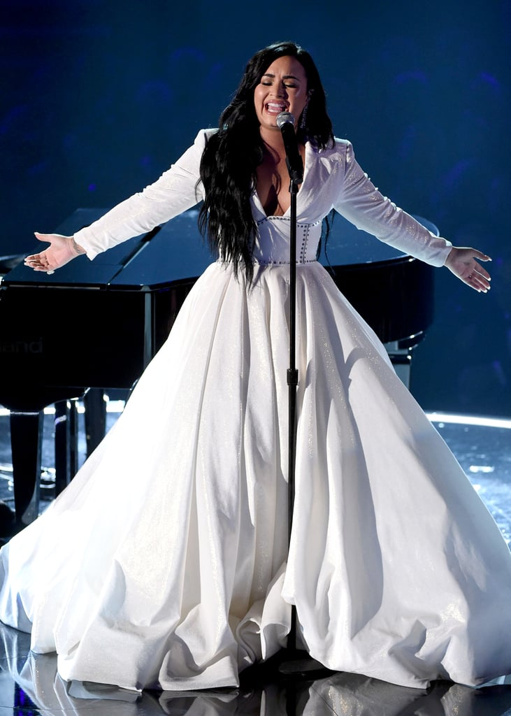 """Demi Lovato delivered a beautifully emotional performance of her new song """"Anyone"""" during Sunday night's Grammy Awards. The 28-year-old singer poured her heart onto the stage in a moment few viewers will ever forget, and she tapped designer Christian Siriano to craft a gown worthy of such a performance.  Shortly after Demi's triumphant return to the stage, Christian sent out a message of support on Twitter. """"I love you and love creating for you!!!"""" he wrote, referencing Demi. His custom gown provided an elegant addition to an already-iconic night for Demi. Her stylist, Law Roach, completed the look with a Zana Bayne corset and Lesilla shoes. Keep reading for a closer look at Demi's unforgettable evening."""