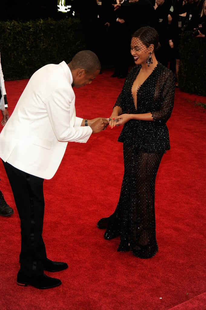 Jay Z placed Beyoncé's ring on her finger after it fell off on the Met Gala red carpet in May 2014.