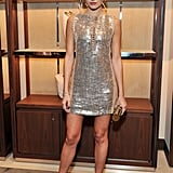 Camilla Belle wore a Salvatore Ferragamo gold sequined minidress for the brand's London store launch in December.