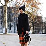 Get Preppy in a Plaid Wool Skirt, Oversize Turtleneck, and White Sneakers
