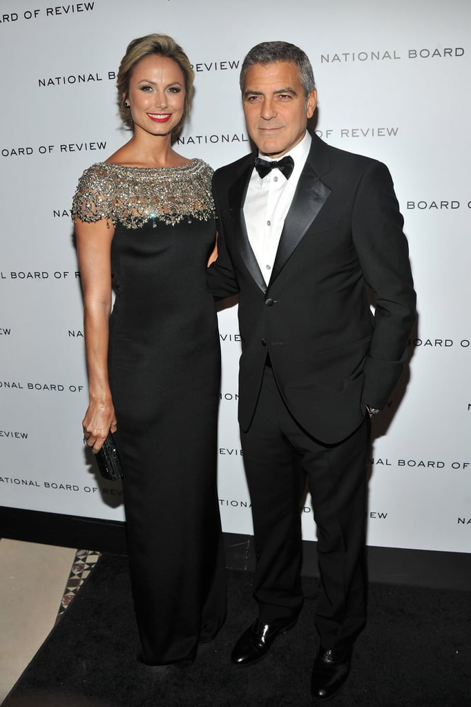 George Clooney had Stacy Keibler by his side for the National Board of Review Awards gala at Cipriani in NYC tonight. Stacy chose a dramatic black Marchesa gown, which complemented George's sexy tuxedo. George was there to accept his best actor honor for The Descendants and support The Ides of March, which landed on NBR's list of 2011's best movies. The award winning fun got started over the weekend at the Palm Springs International Film Festival, where George picked up the Chairman's Award for his work in both big-screen hits.  In addition to George's recent red-carpet commitments, he made time to tape Inside the Actors Studio and stop by Good Morning America today in the Big Apple. His busy schedule continues with the Critics' Choice Awards on Thursday, when he'll find out if The Descendants takes home any of its seven possible wins, or if Ides grabs the statue for best acting ensemble.