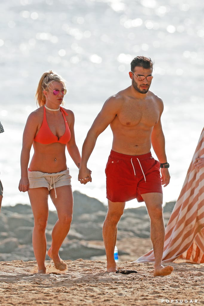 After closing out her four-year Las Vegas residency at Planet Hollywood on New Year's Eve, Britney Spears jetted off to Hawaii, where she's been enjoying some well-deserved R&R over the last few days. On Thursday, the singer returned to the beach with boyfriend Sam Asghari and they both put their incredibly fit figures on display as they walked along the sand. We also couldn't help but notice that Britney was still sporting the same diamond ring we recently saw her wearing on her left hand. It's unclear whether the sparkly bauble is simply a promise ring or something more, but the two have been going strong since 2016. Only time will tell.       Related:                                                                                                           11 Men Who Were Lucky Enough to Date Britney Spears