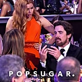 Amy Adams was surprised by something on Christian Bale's phone.
