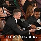 Brad Pitt got a pizza from Chiwetel Ejiofor.