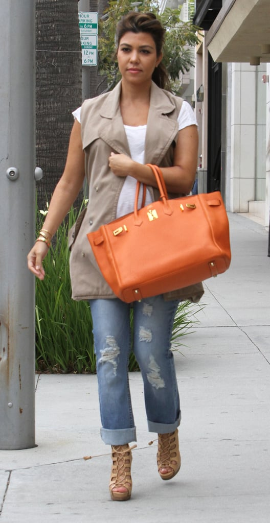 In February Kourntey was just starting to show. Luckily she had her trusty Hermés Birkin to cover the bump (almost!).