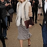 Olivia piled on the cozy layers by pairing a fuzzy vest with a warm chunky knit and a mohair skirt.