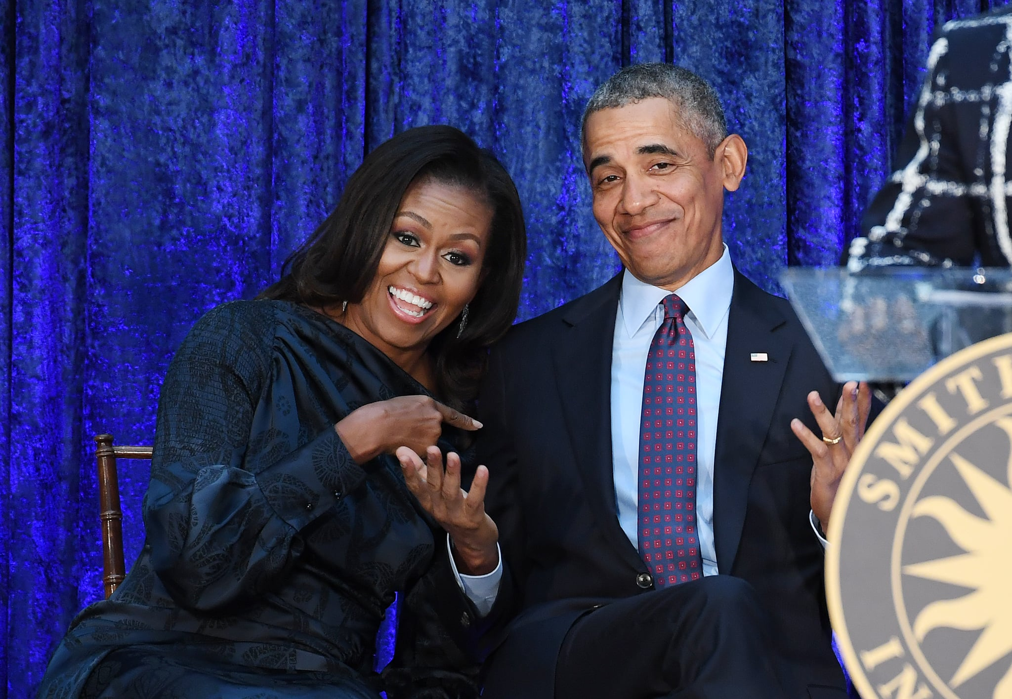 WASHINGTON, DC - FEBRUARY 12: Former First Lady Michelle Obama and former President Barack Obama are seen after their portraits were unveiled at the Smithsonian National Portrait Gallery on Monday February 12, 2018 in Washington, DC. The former President's portrait was painted by Kehinde Wiley while the former First Lady's portrait was painted by Amy Sherald. (Photo by Matt McClain/The Washington Post via Getty Images)