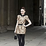 Lily Collins was perfectly ladylike in a gold-hued mini.