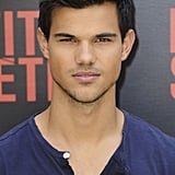 Taylor Lautner gave a coy smirk for photographers.