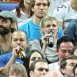 Kirsten Dunst had a drink while watching the game.