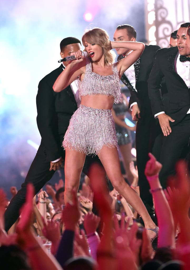 """Taylor Swift is making her big return to the MTV VMAs stage this month. Following the release of her upcoming Lover album, the """"ME!"""" singer will hit the stage for a very special performance on Aug. 26. The last time she attended the show was all the way back in 2015, so it goes without saying that fans are super excited. Taylor certainly has a long history of mending feuds at the VMAs. In 2015, Nicki Minaj proved there was no more bad blood between her and Taylor when she brought out the singer during her opening number, and that same year, Taylor and then-friend Kanye West also hugged it out on stage, six years after he famously interrupted her acceptance speech. Maybe this time Taylor and Katy Perry will flaunt their newly mended friendship? Ahead of Taylor's VMAs appearance, take a look at her best moments at the award show."""