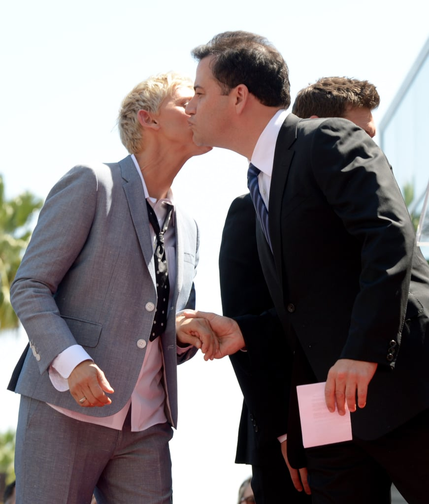 Ellen DeGeneres received a congratulatory kiss from Jimmy Kimmel.