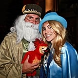 Fans dressed as Dumbledore (with his phoenix Fawkes) and Fleur Delacour await the screening of Harry Potter and the Deathly Hallows at Grauman's Chinese Theatre in LA.