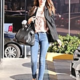 Miranda Kerr sported this Equipment silk snake-print tee ($168) with skinny jeans, a black blazer, black suede flats, and her trusty Givenchy Antigona bag ($2,405) while running errands in LA.