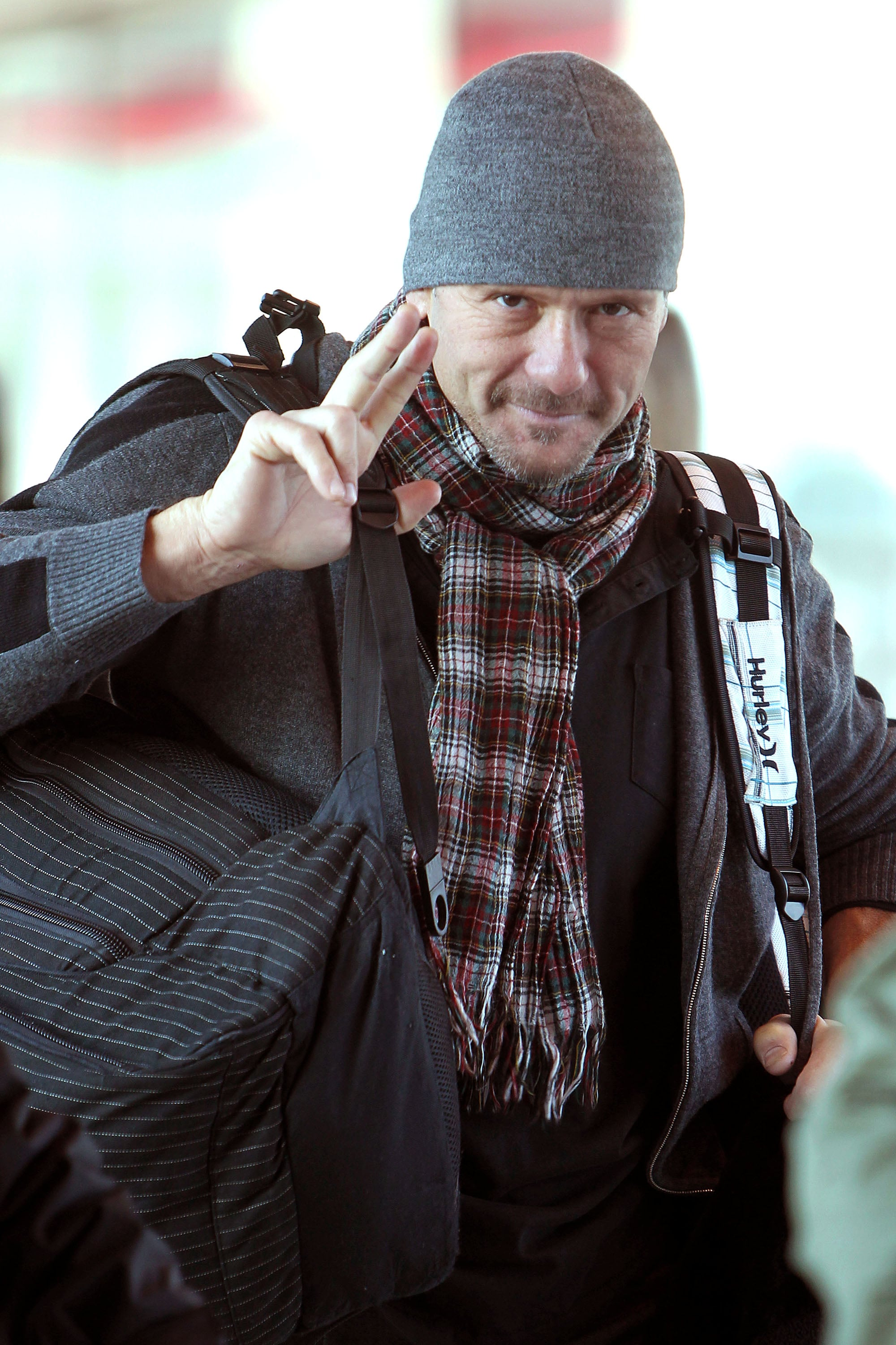 Tim McGraw threw a peace sign up after landing in London.