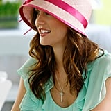 The pink cloche hat serves two purposes: throwing us back to the year 2007, and drawing our attention into Blair's chestnut ringlets.