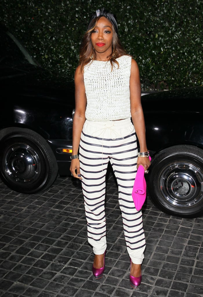 British singer Estelle made her striped pants pop with two bright pink accents: her clutch and metallic round-toe pumps.