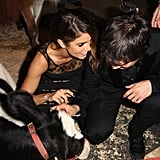 They crouched down together to pet a calf during a Heifer International event in August 2014.